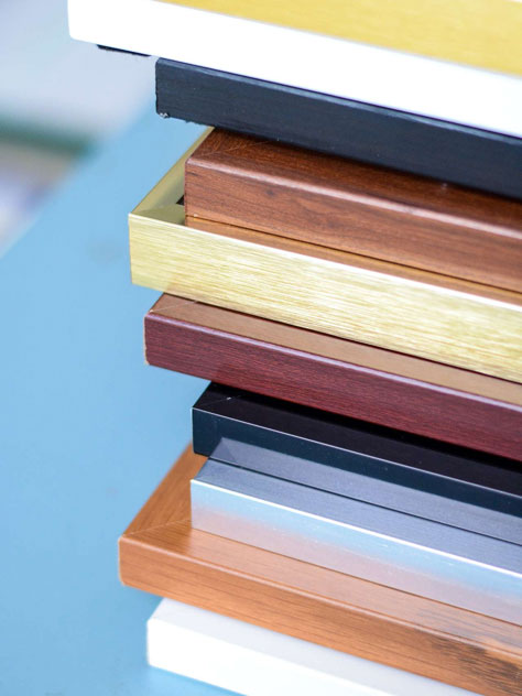 stack of metal and wood frames close up
