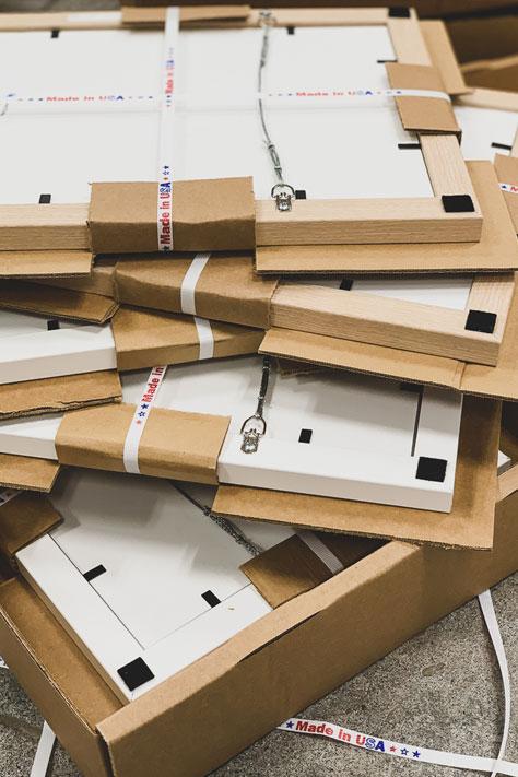 bundled stack of custom frames ready for shipping