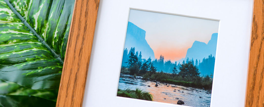 Wodden framed photo of river with mountains