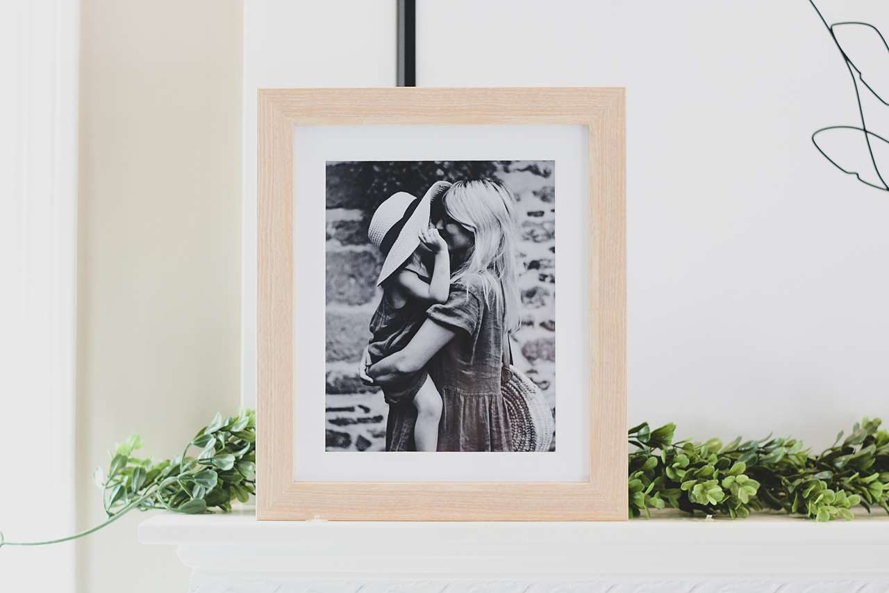 Honey colored frame with black and white photo of mother and child