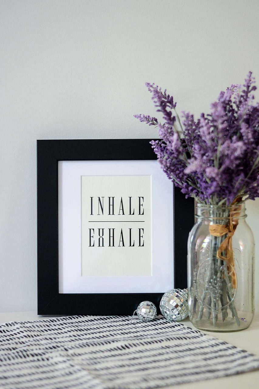 "Black frame with saying, ""Inhale Exhale"""
