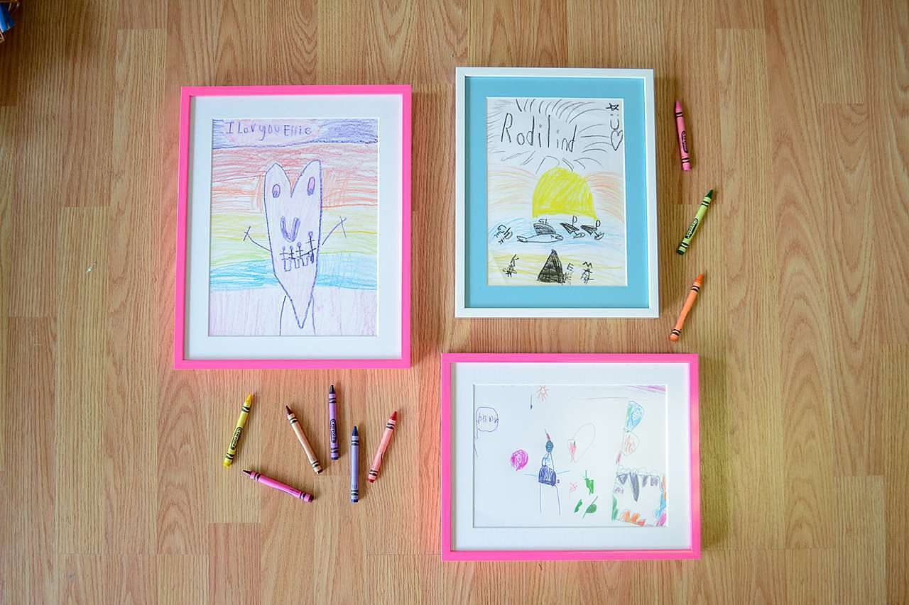 Children's crayon drawings in frames