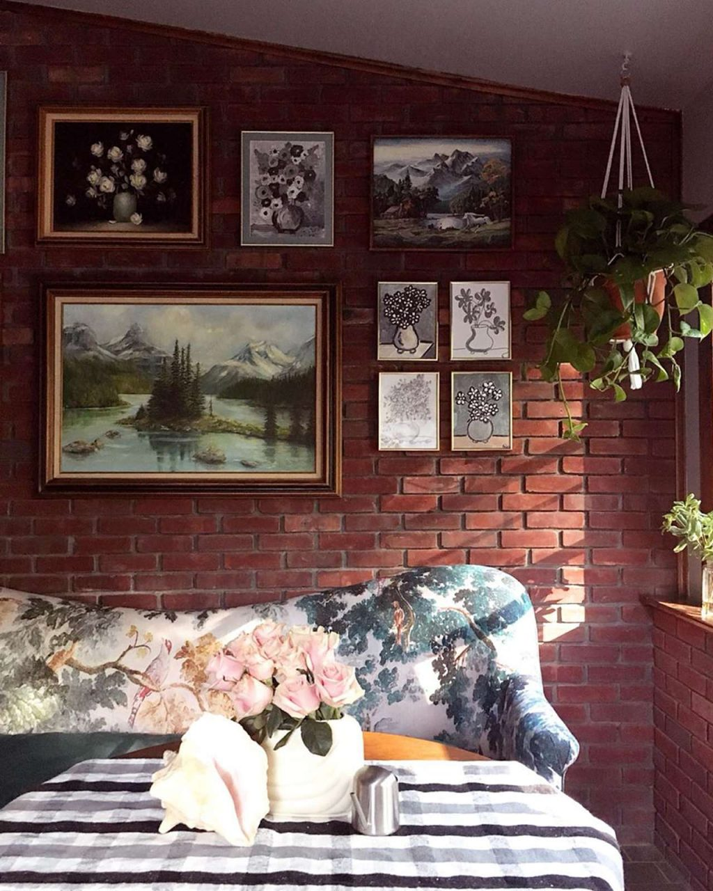 picture frame gallery on brick wall