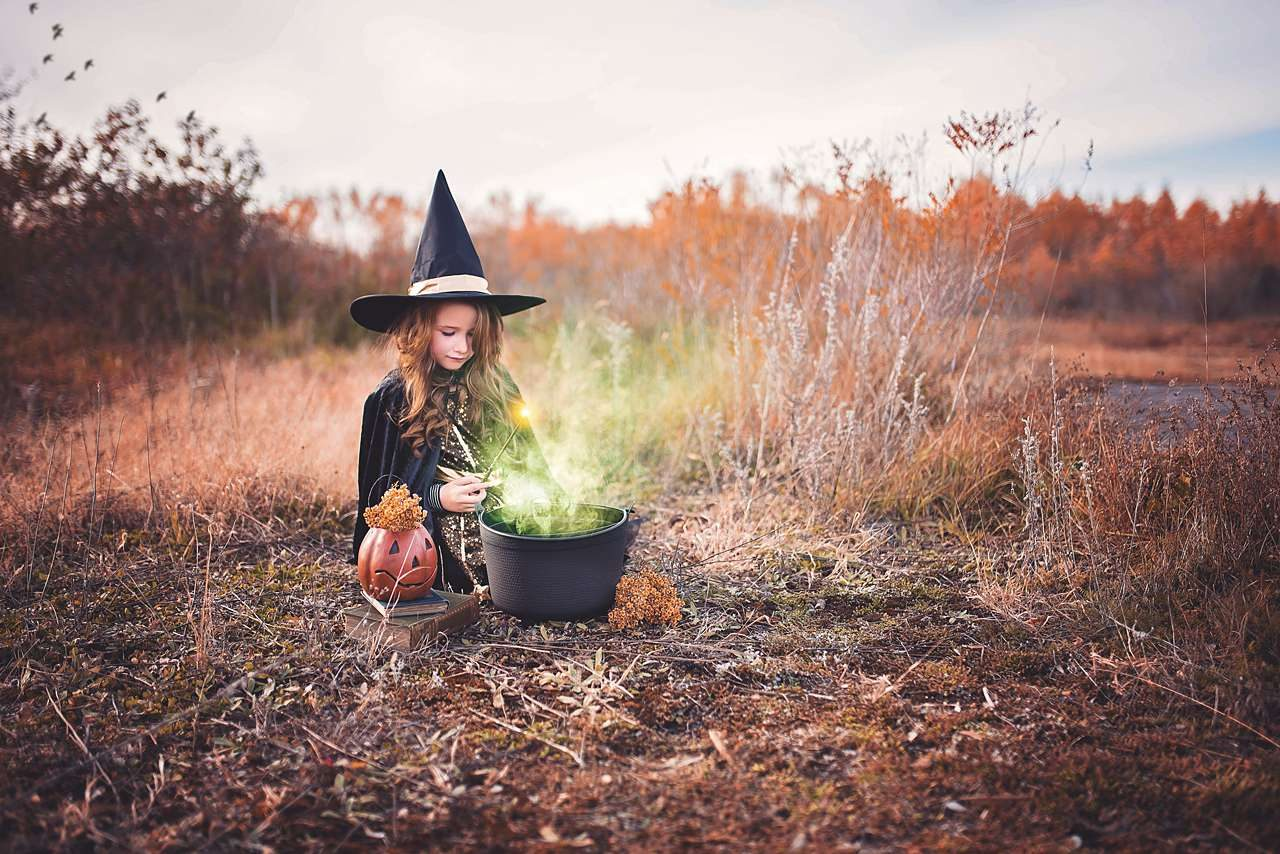 young girl dressed as a witch