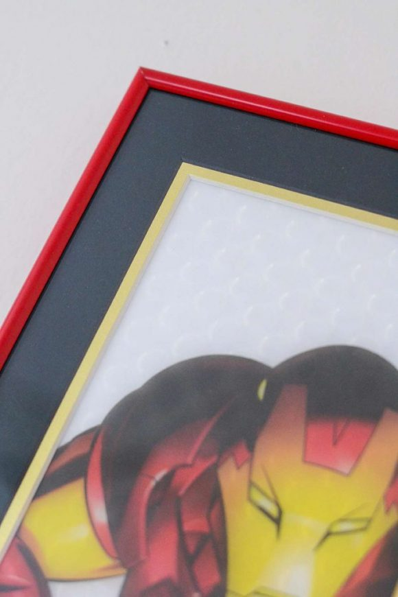 Red metal picture frame of Iron Man print