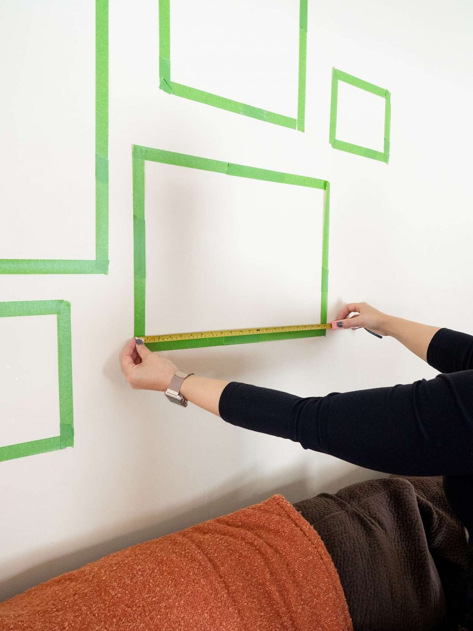 Use painter's tape to hang picture frames