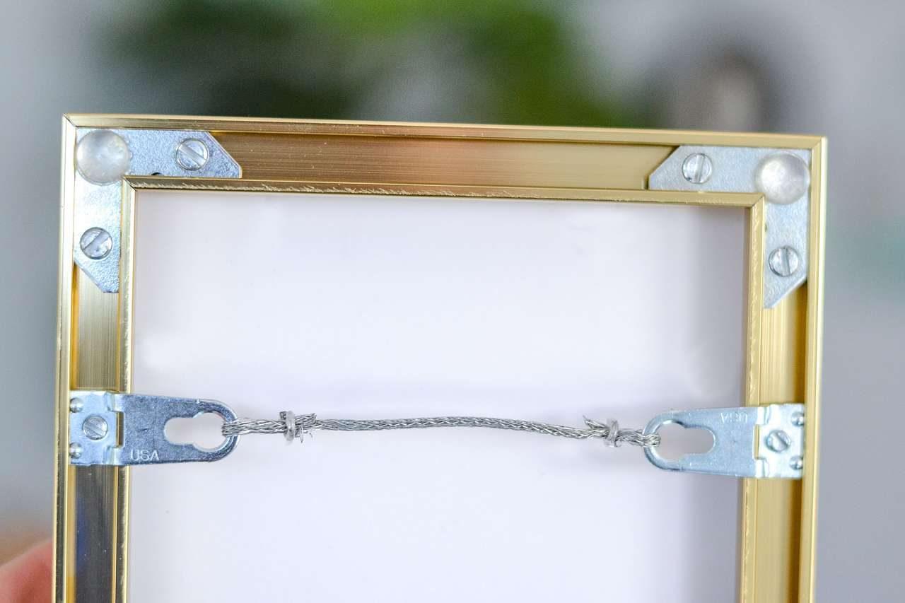 Metal picture frame hardware
