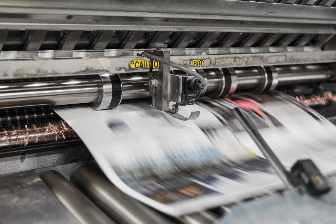 Photo printing through a professional printing press