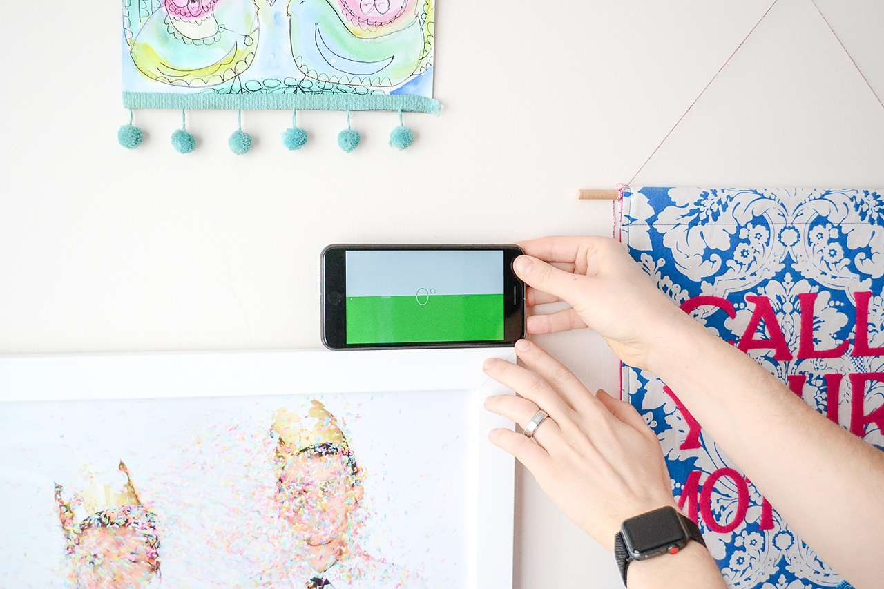Keep picture frames hanging level