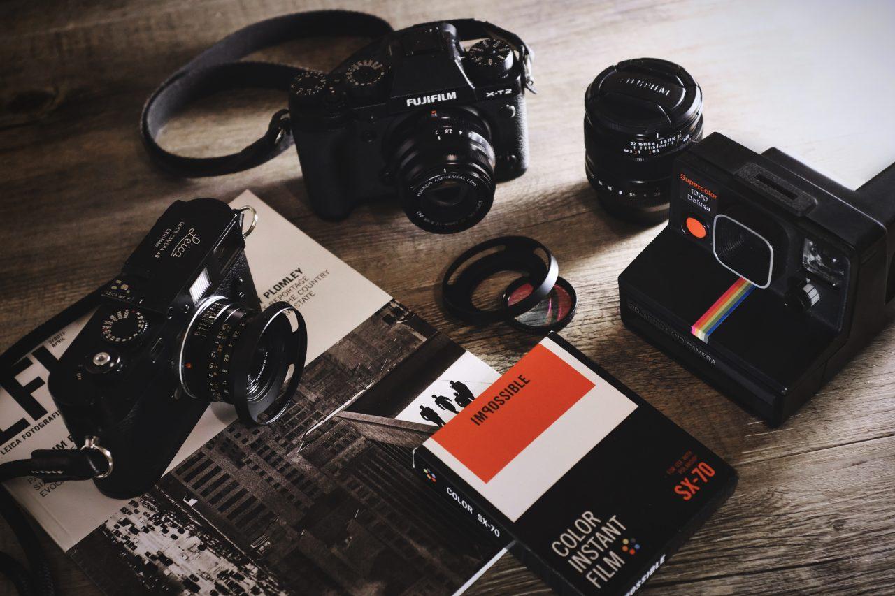 Assortment of classic cameras, lenses, and film