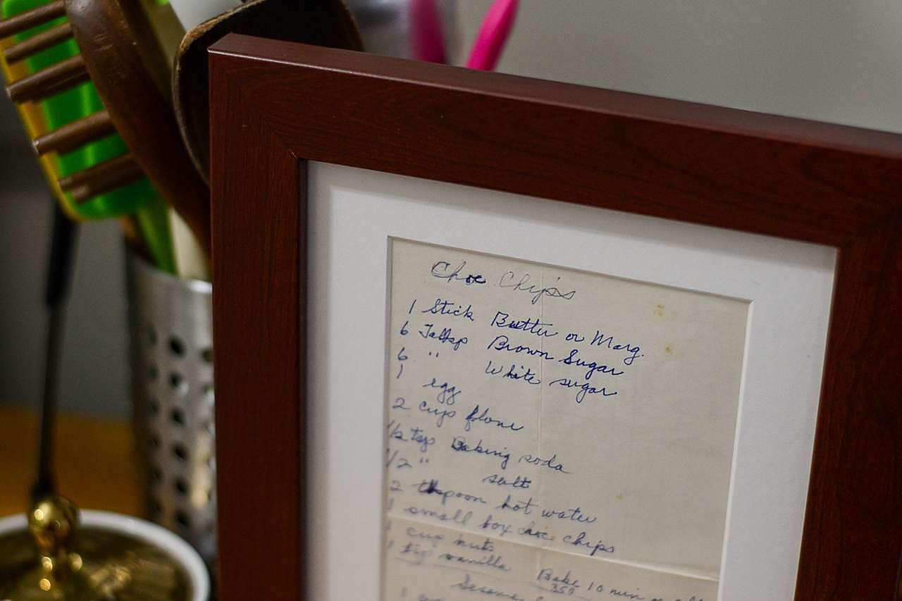 Old, handwritten recipe in a wooden frame