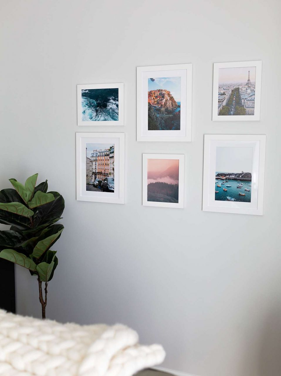 White room with white frames of world locations