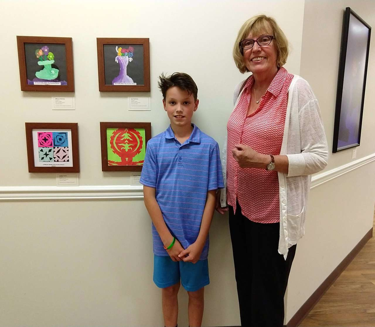 Student posing with art at Maryland Hospital