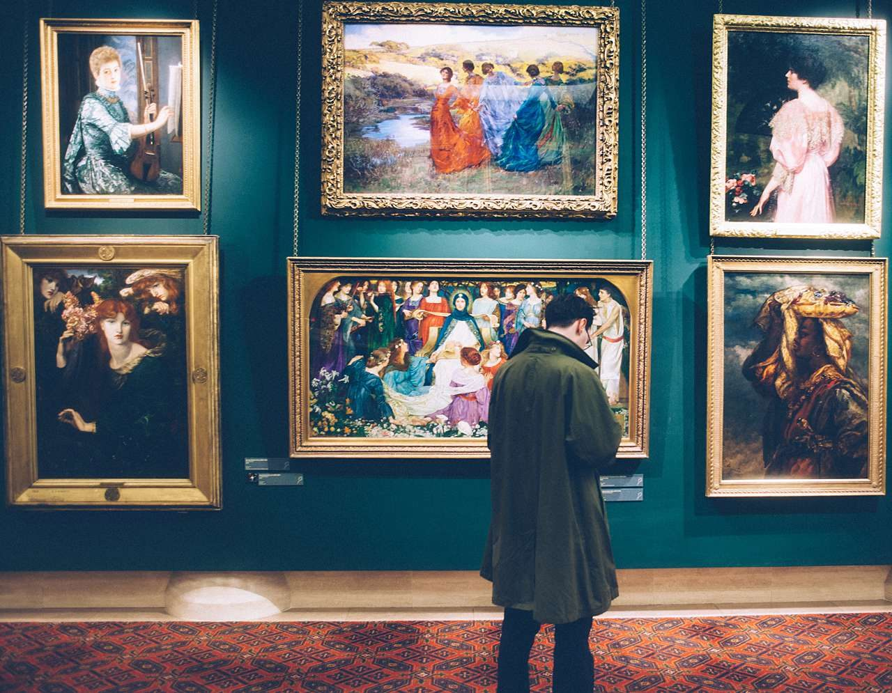 Museum paintings in ornate picture frames