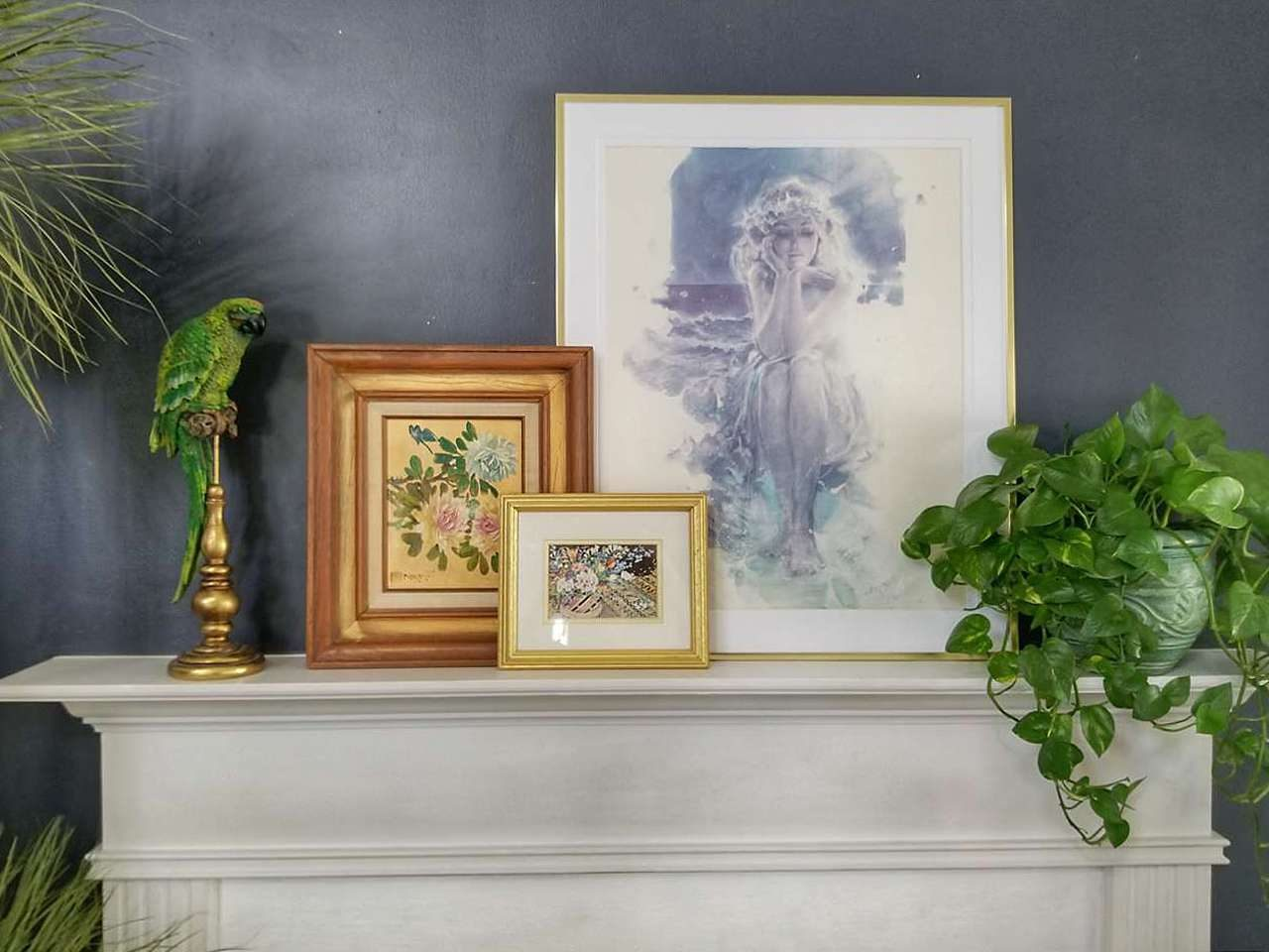 Triple picture frames on fireplace