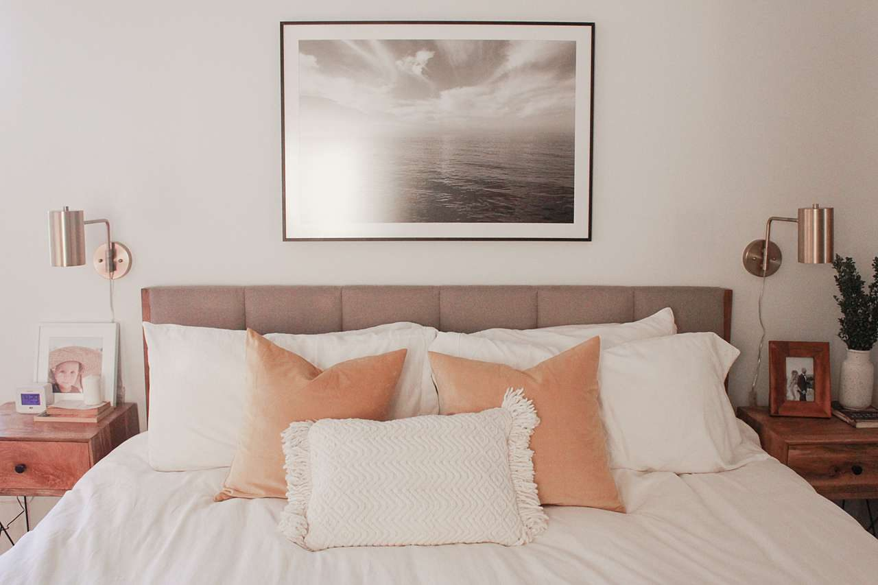 Large photo frame above bed