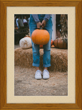 Fall art print - person holding pumpkin in front of hay - Derby in Hazel with French Vanilla matting