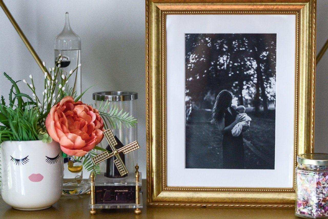 Gold frame on shelf