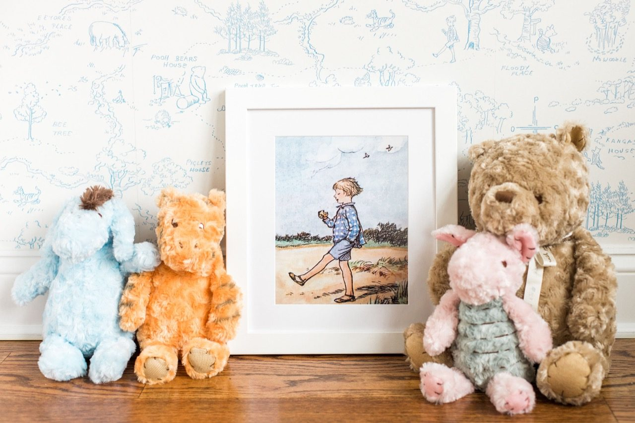 Framed Christopher Robin with stuffed animals