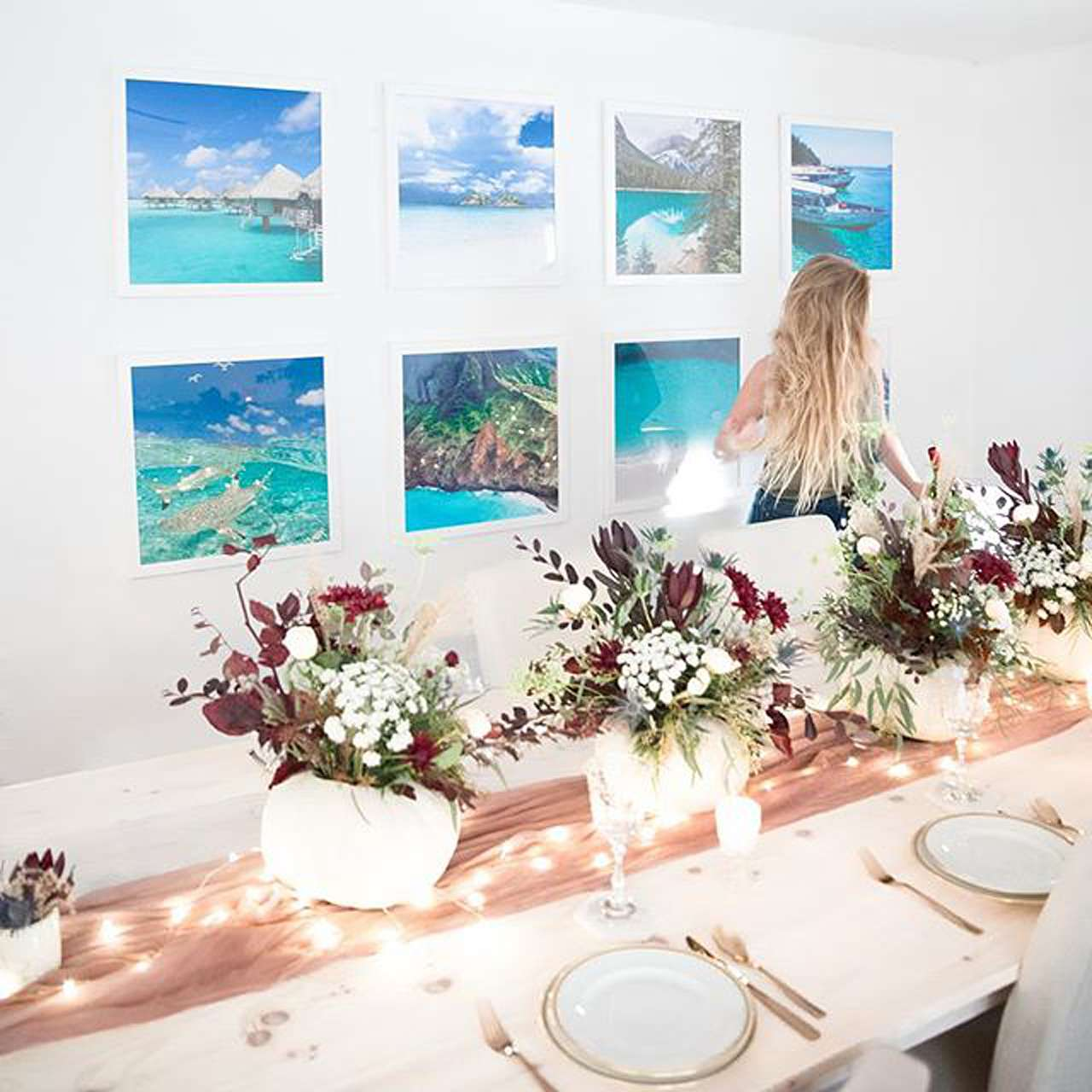 holiday table display with gallery wall