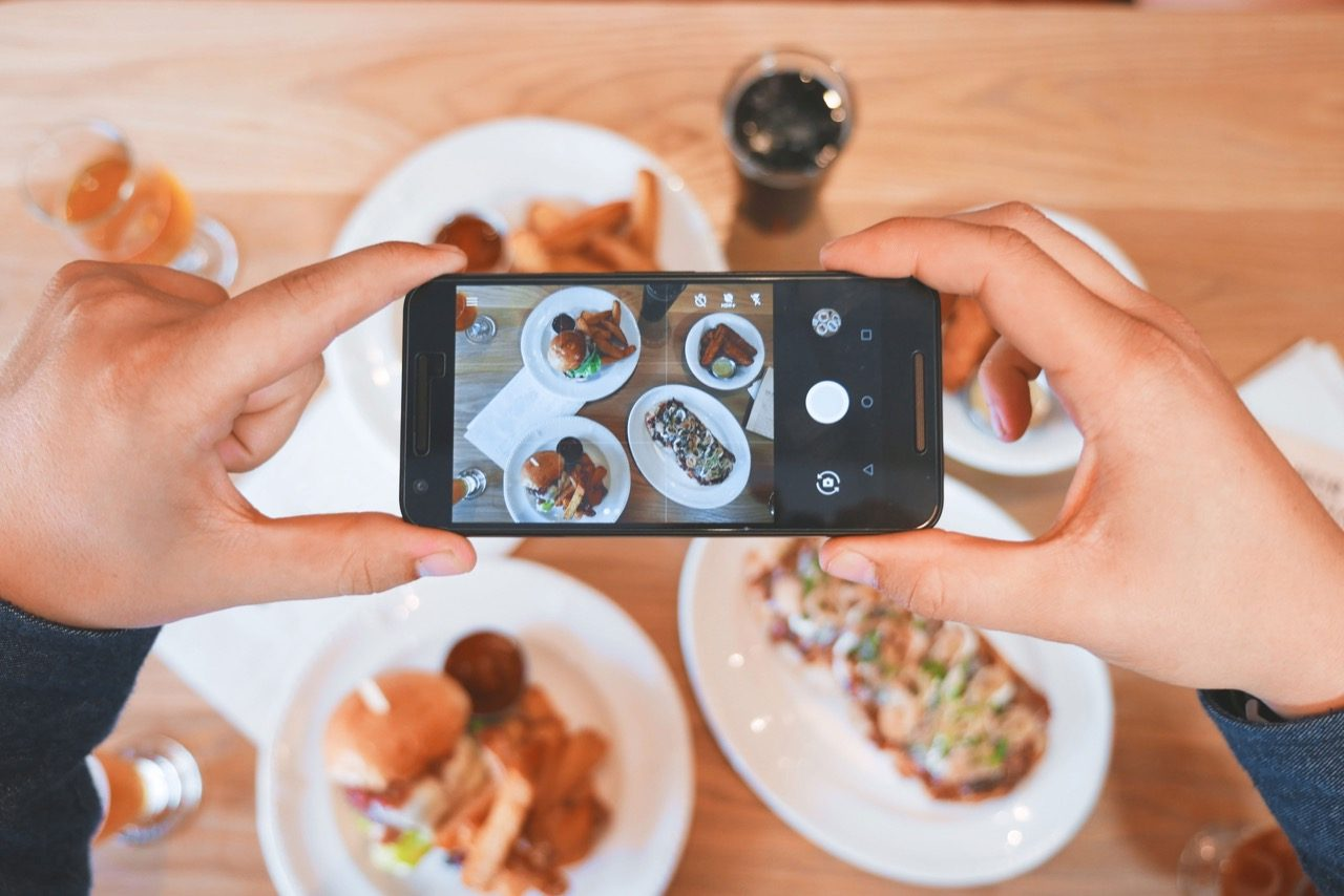 person taking a picture of food