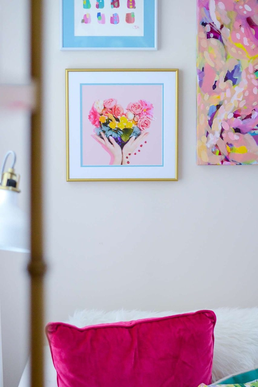 gold frame with colorful art and double matting with blue accent