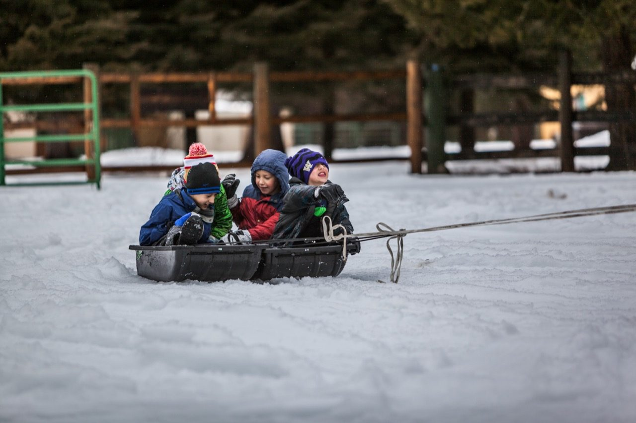 Kids being pulled in a sled.