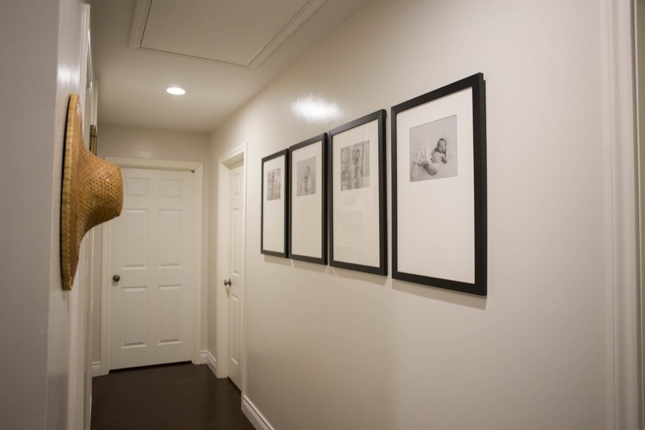 large frames on hallway wall