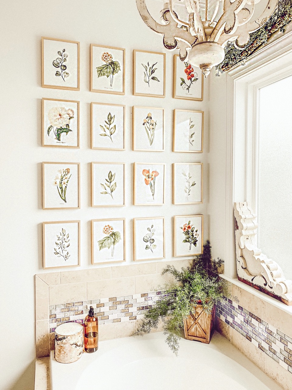 large gallery wall in bathroom