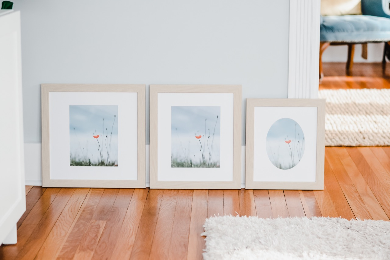 three floral photo frames