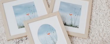 three photo frames with different matting sizes