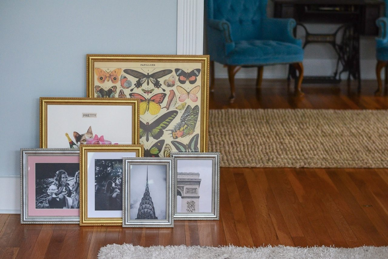 group of framed pieces- different styles