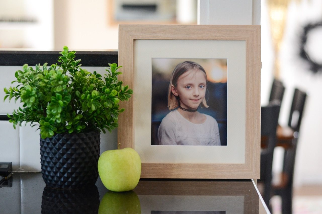 little girl framed school photo