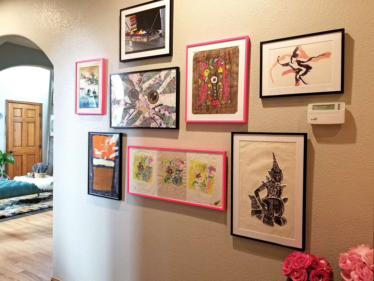 pink and black gallery wall