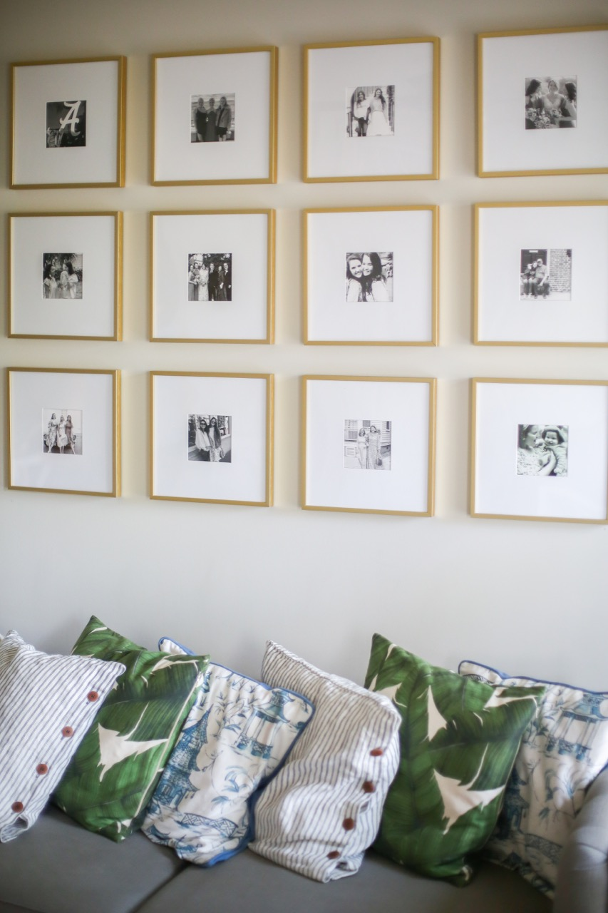 gallery wall of gold frames