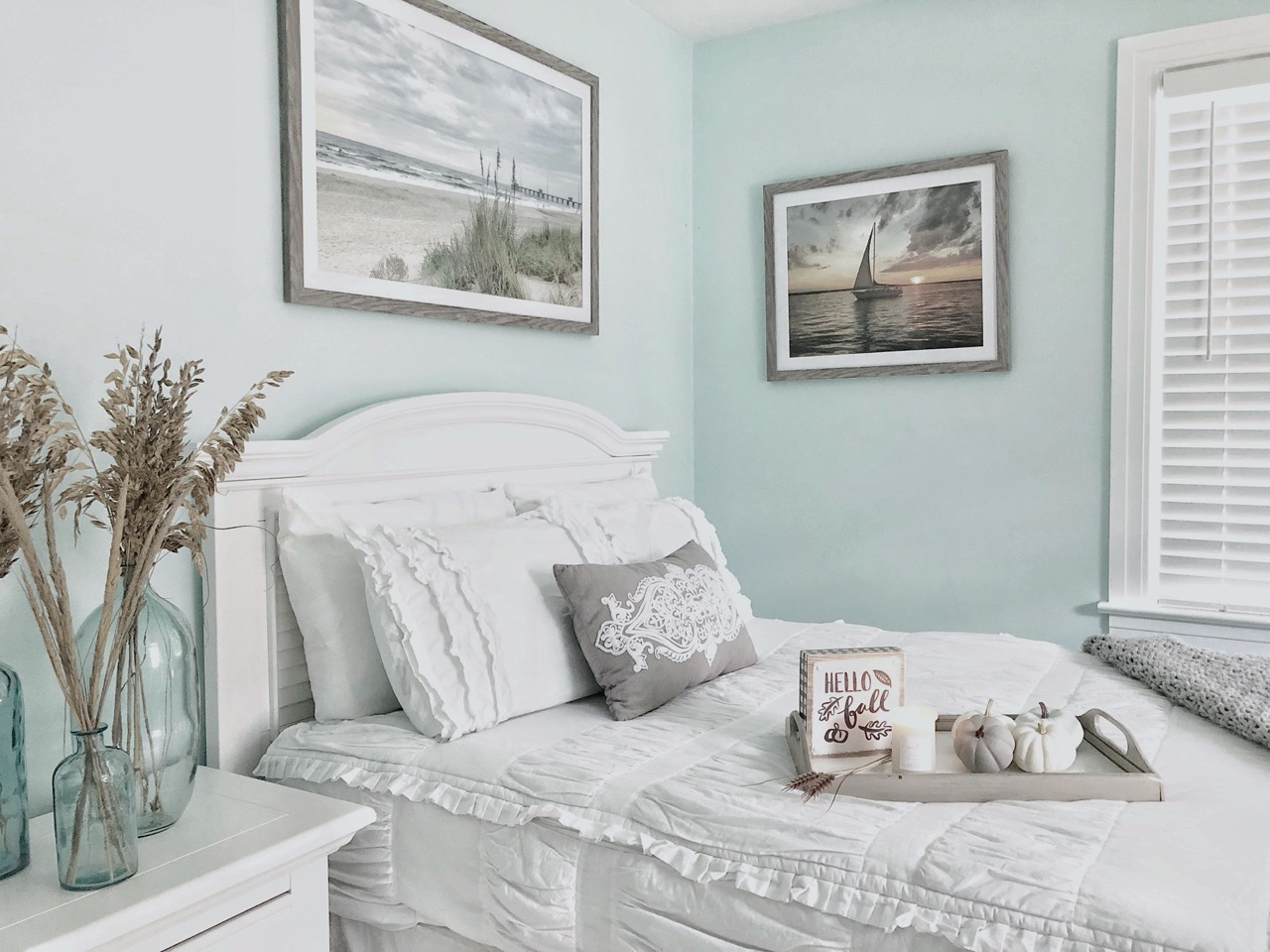 guest bedroom with beach photos