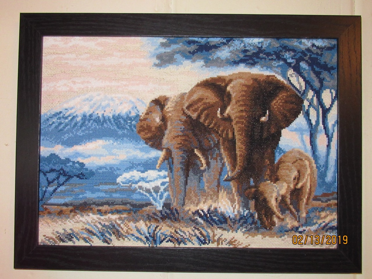 cross-stitch of elephants