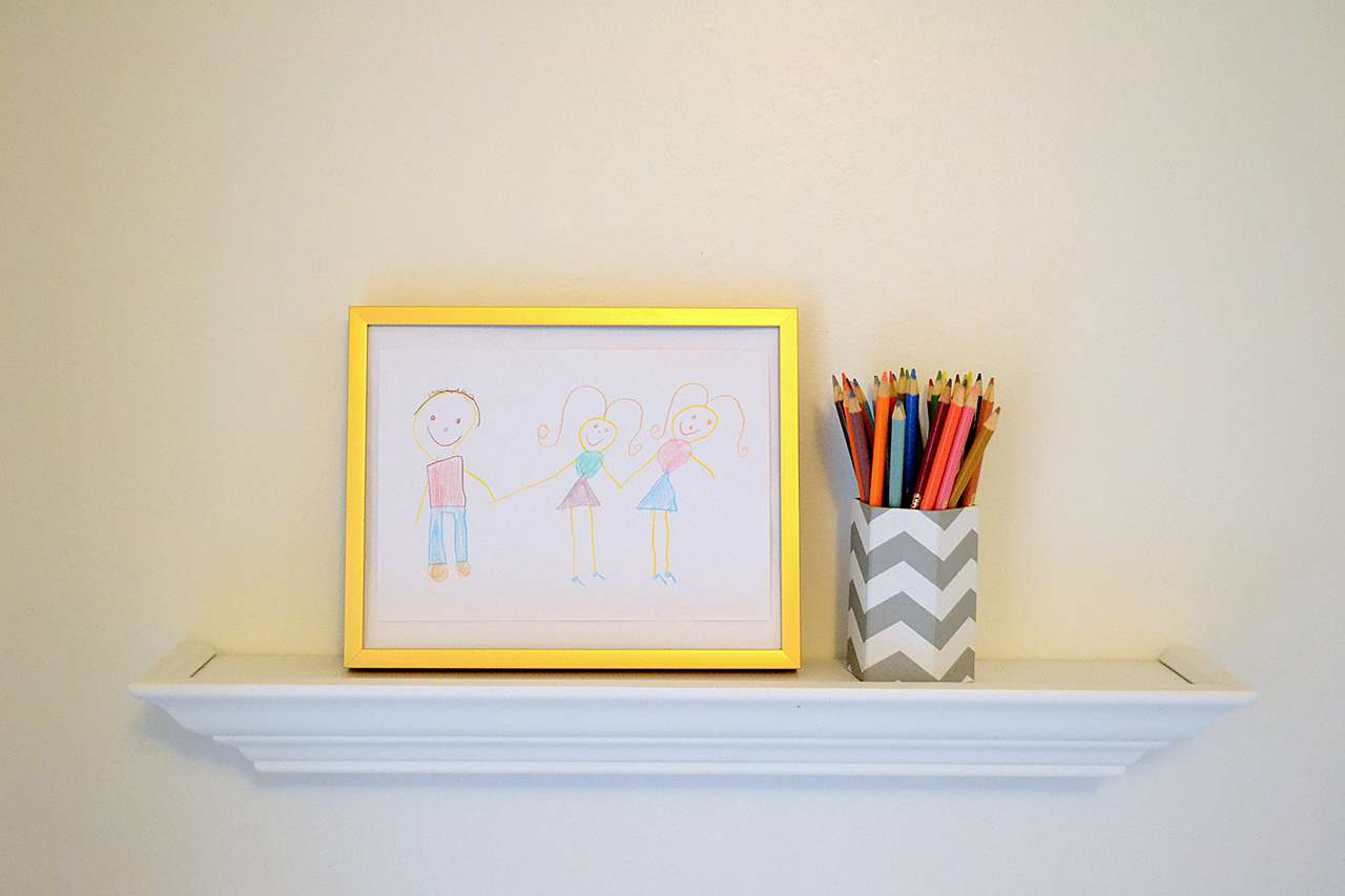 framed drawing of stick figures