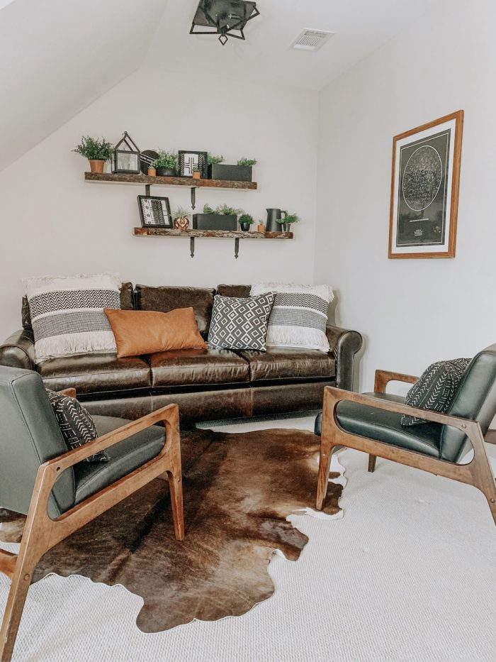 Living room in farmhouse style home with framed art
