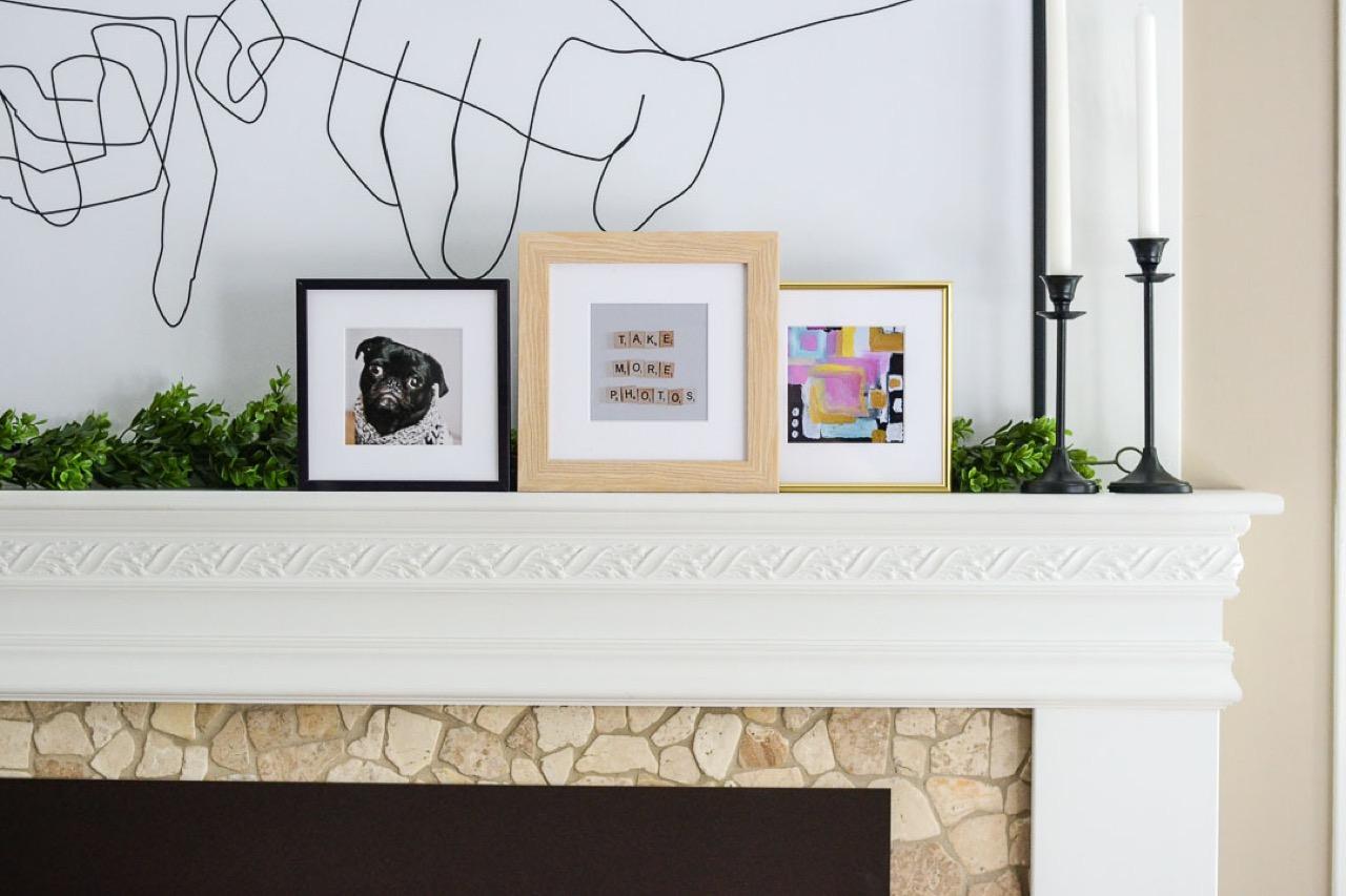 Different photo frames on ledge