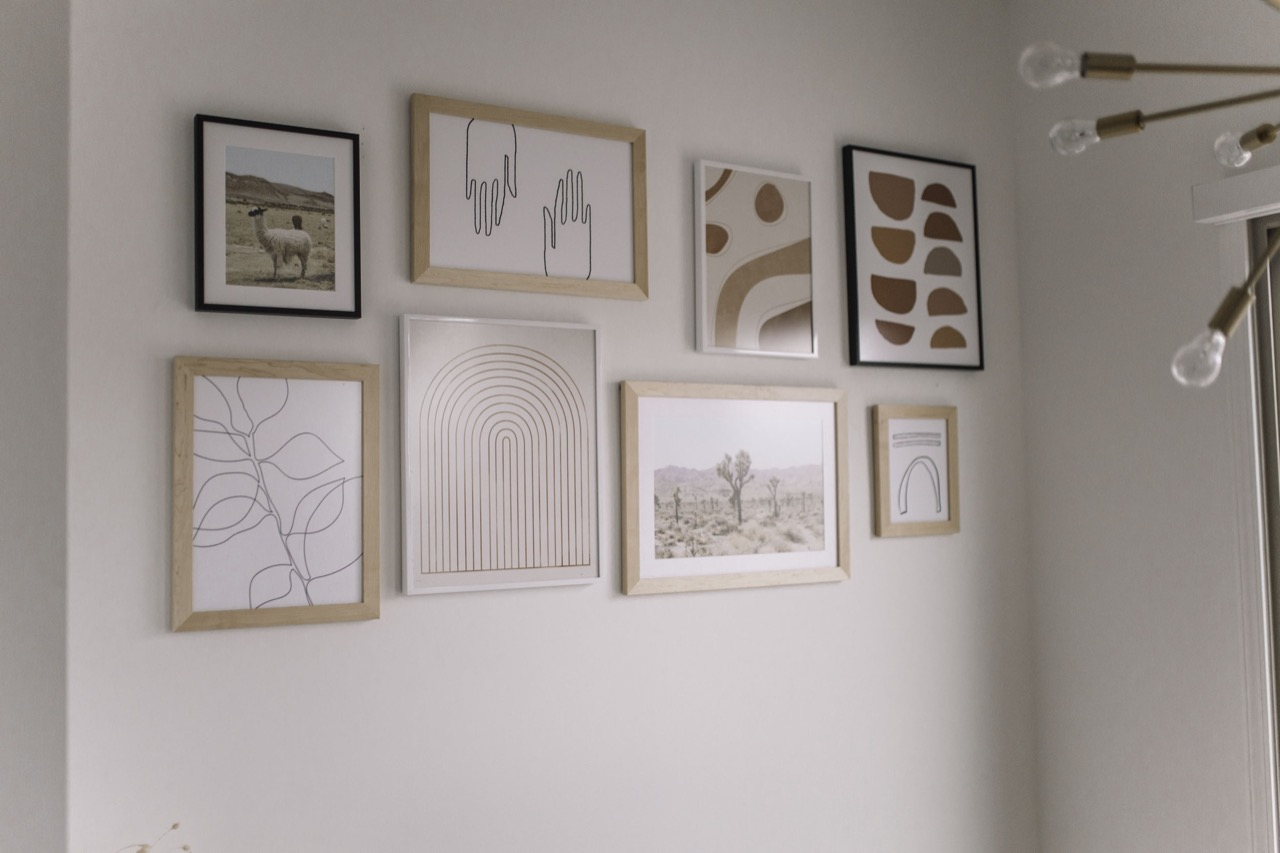 gallery wall of mixed art