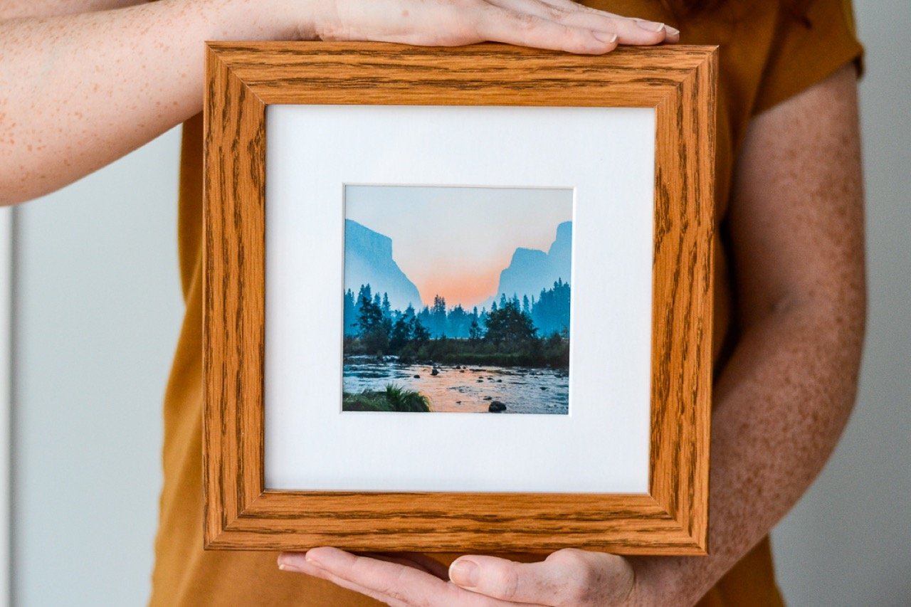 framed photo of sunset and lake