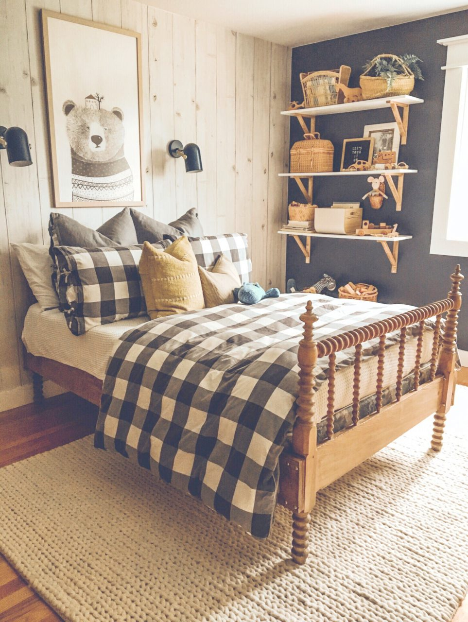 plaid bedspread with large wall art