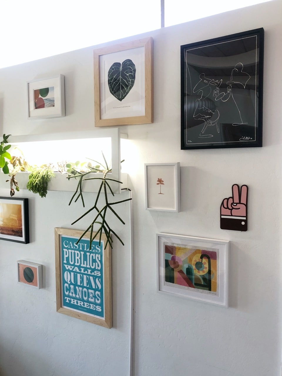 gallery wall with framed art