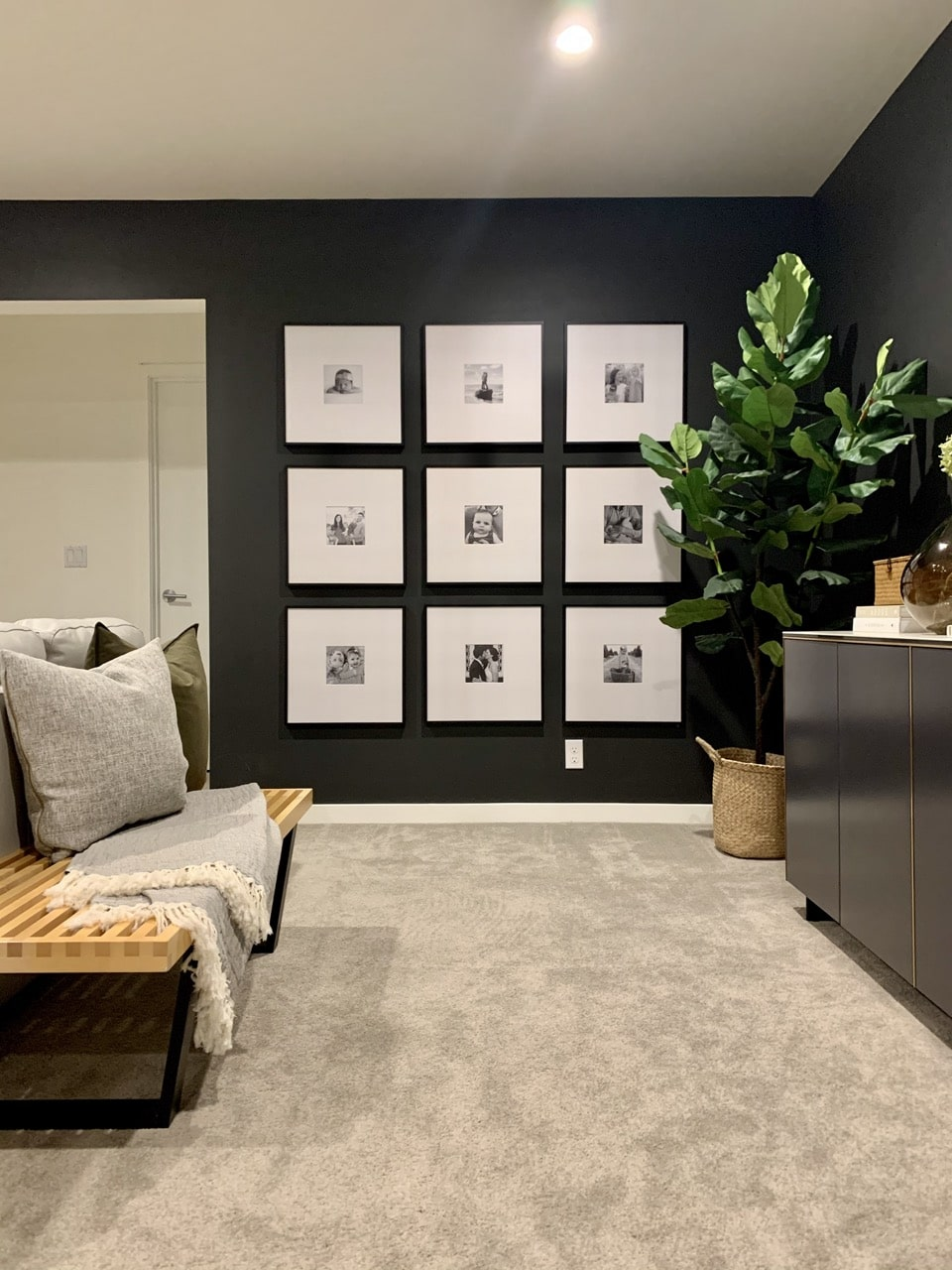 large gallery wall in basement
