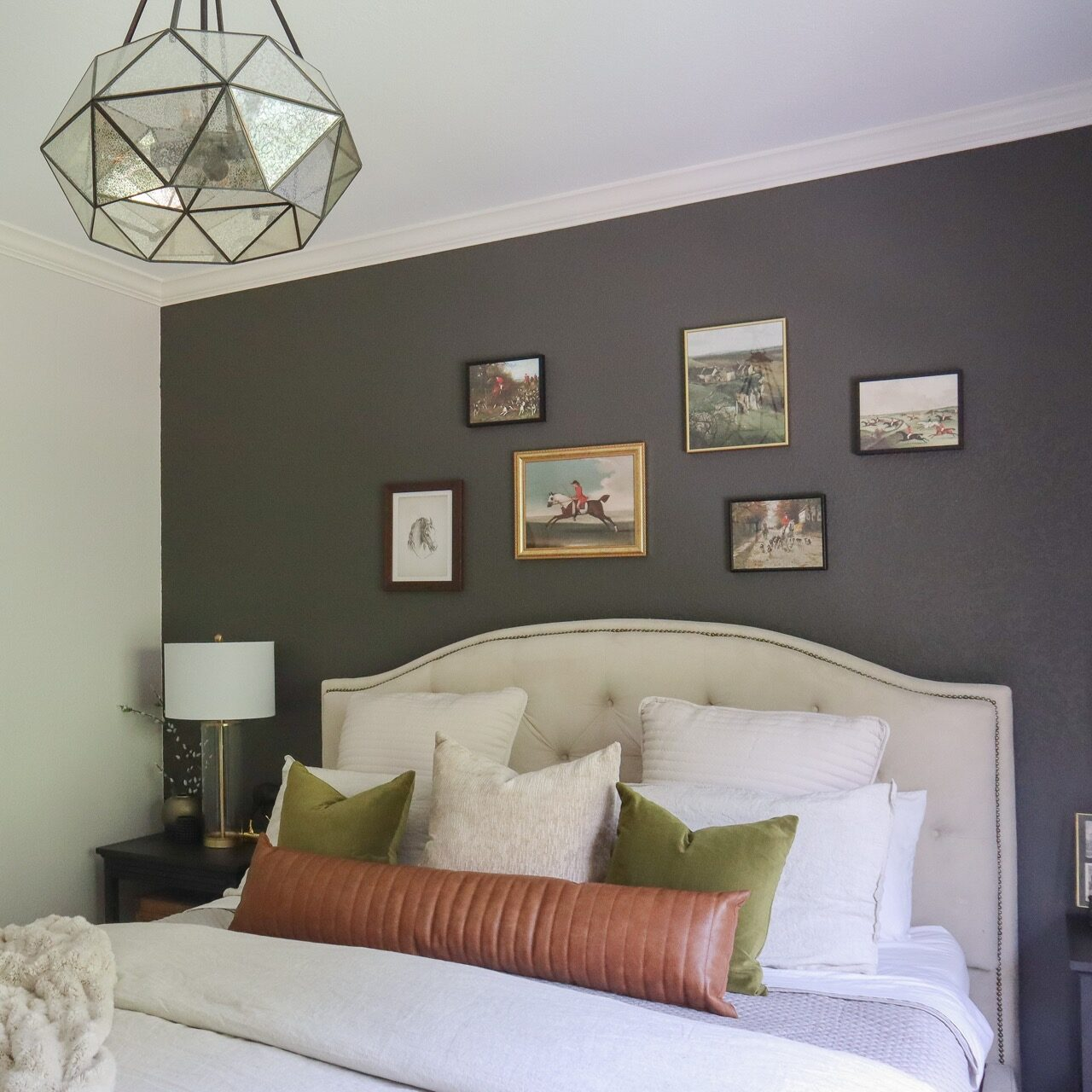 gallery wall above bed
